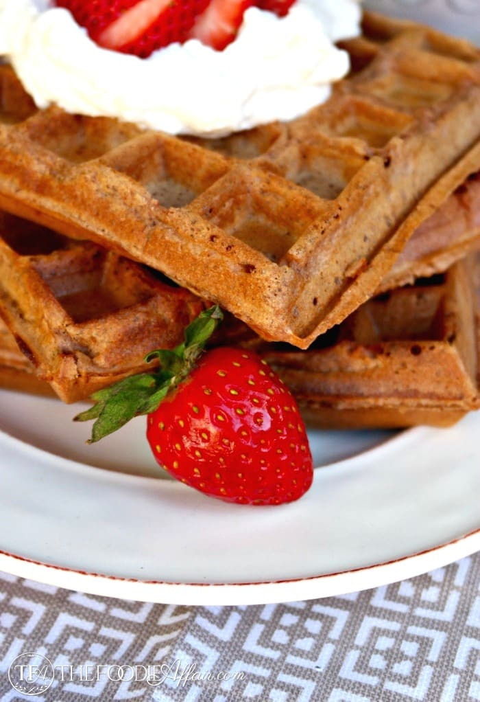 healthy chocolate waffle recipe made with whole wheat flour topped with whipped cream
