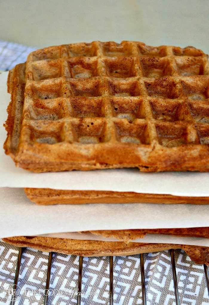 chocolate waffles with parchment paper between the layers for freezing