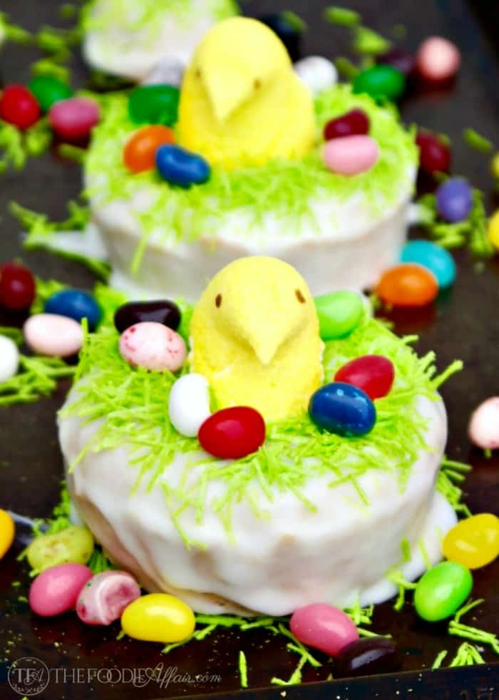 Easter Peeps peeking from the middle of a lemon baked donut