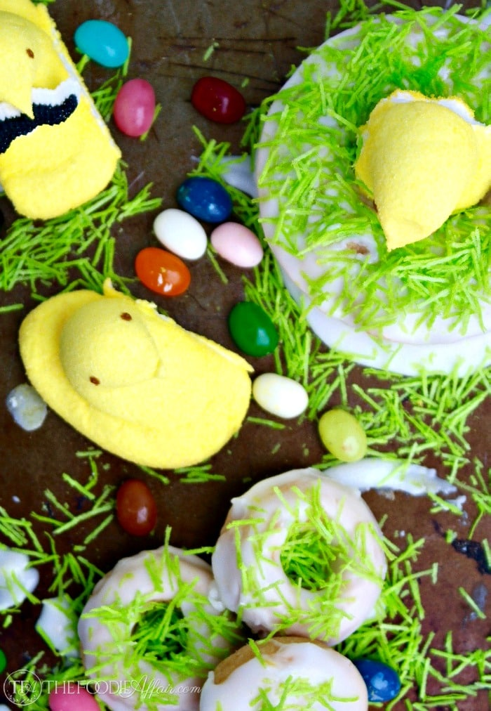 Peeps Easter treats peeking out of a baked lemon donut