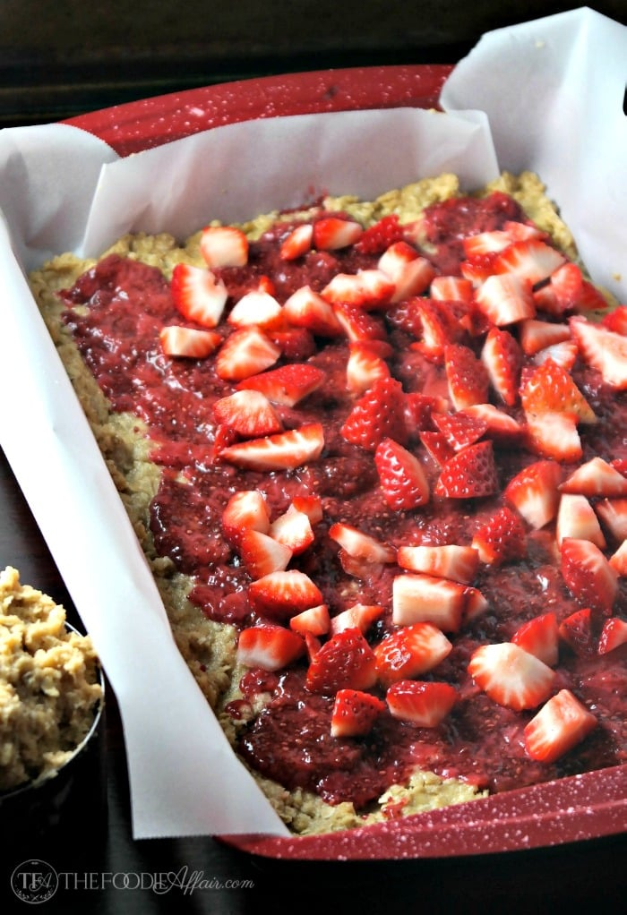 Strawberry oat bars topped with fresh strawberries