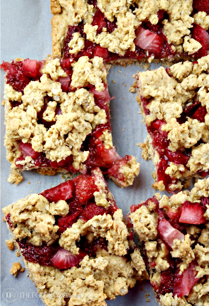 Strawberry oat bars on white parchment paper
