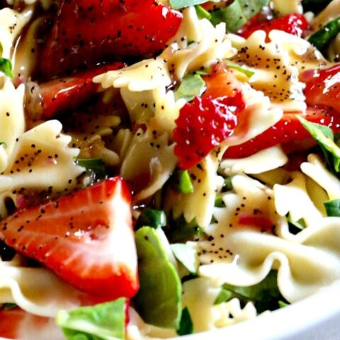 Strawberry Spinach Pasta Salad in a large white serving bowl