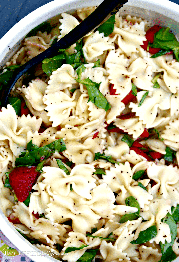 Strawberry Spinach Pasta Salad in a white bowl
