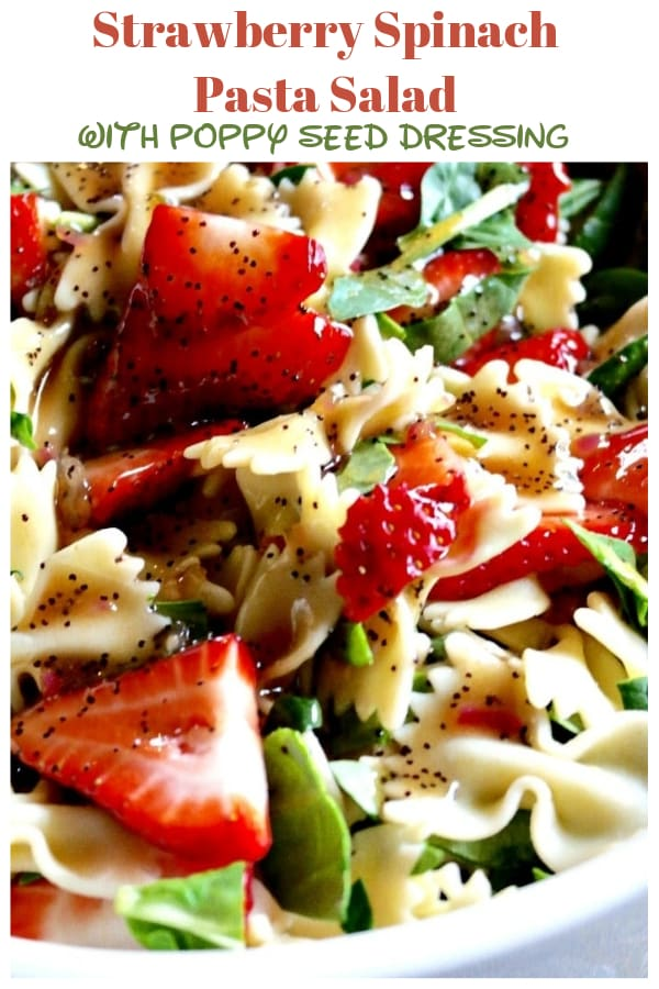 Strawberry Spinach Pasta Salad with light poppy seed dressing! Filled with fruit and veggies making this a great dish to share at a potluck or cookout! #pasta #strawberry #cookout #potluck | www.thefoodieaffair.com