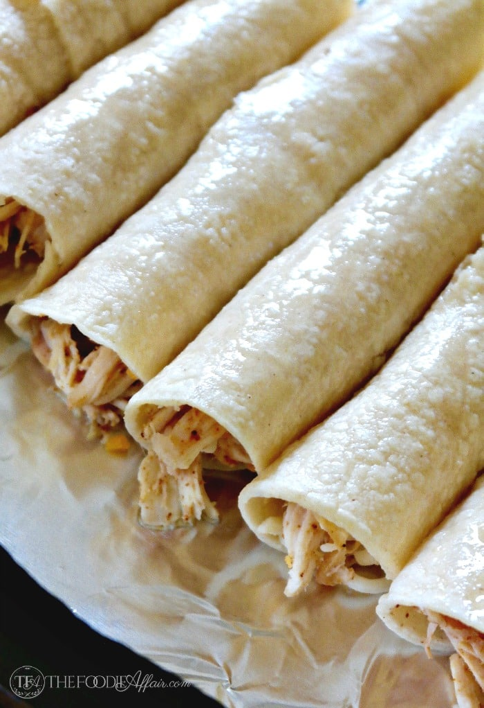 Baked Chicken Taquitos filled with seasoned shredded chicken and ...