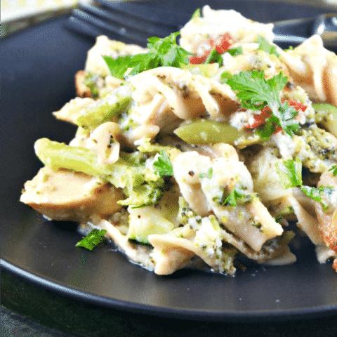 chicken vegetable casserole on a black plate
