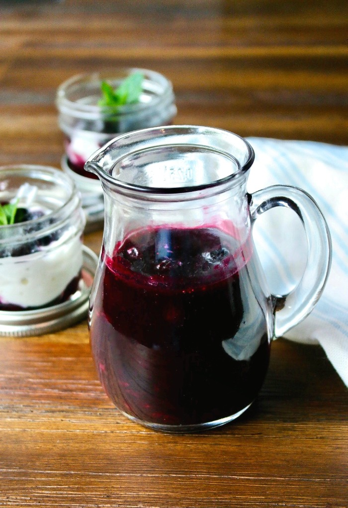 Homemade blueberry sauce in a glass decanter