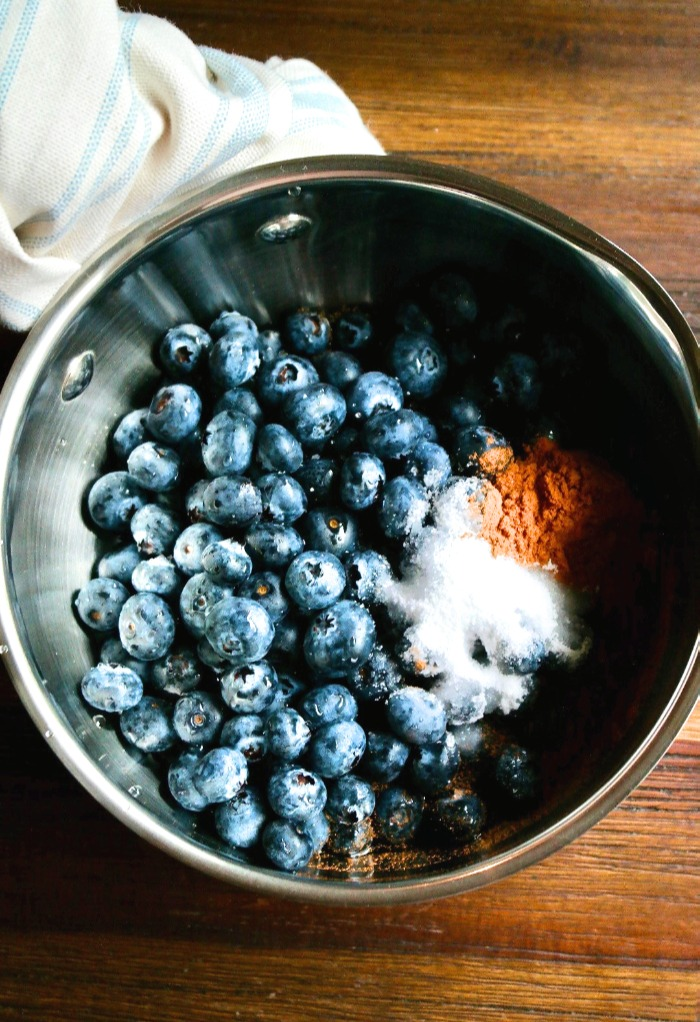Blueberries in a saucepan with cinnamon