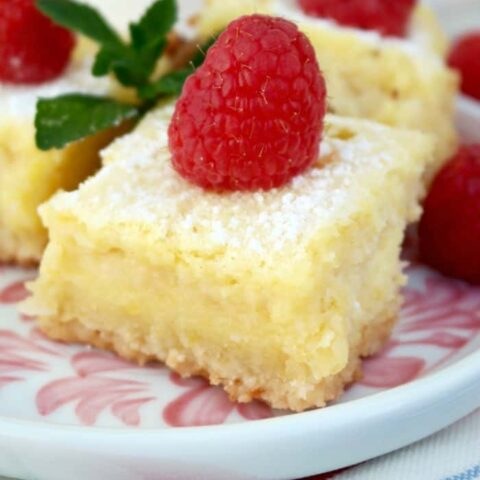 Lemon Bars gluten free recipe with a fresh raspberry on top