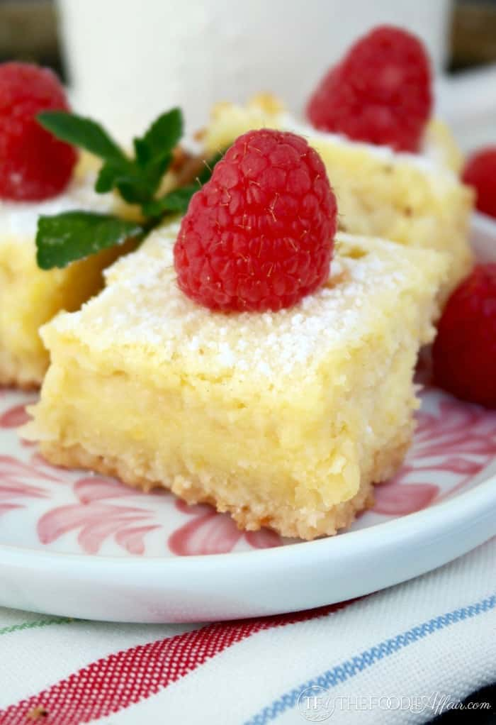 lemon bars with a raspberry on top