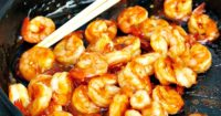 Spicy Tequila Shrimp marinaded in a sweet and spicy ingredients is delicious over rice, pasta or served as it is as an appetizer! The Foodie Affair