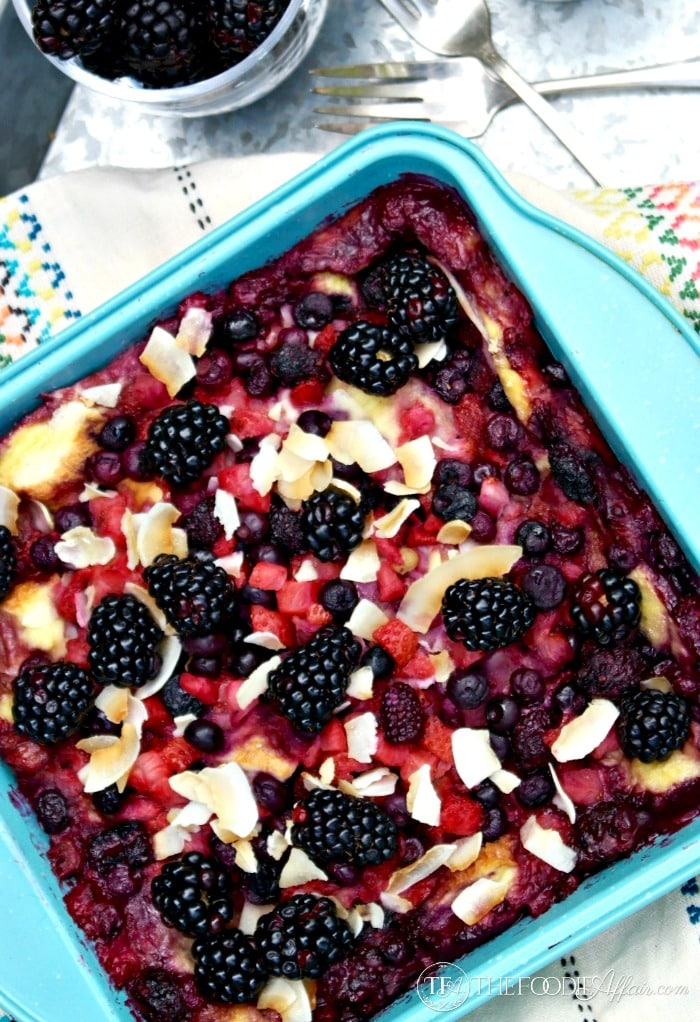 Overnight Fruit Breakfast Casserole with a mix of frozen and fresh berries topping an egg and coconut milk base! The Foodie Affair