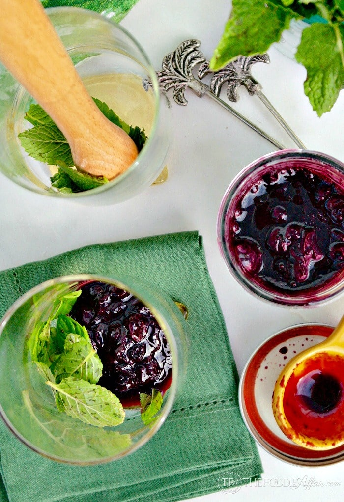 Blueberry Mojito Cocktail made with fresh mint, blueberries, lime juice, rum and a splash of club soda!