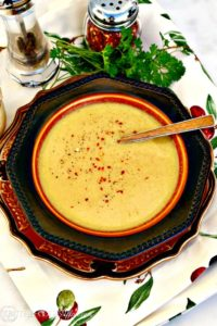 This creamy vegan cauliflower soup will delight your tastebuds with flavorful spices like cumin, turmeric, cardamon with a sprinkle of red pepper to spice it up!