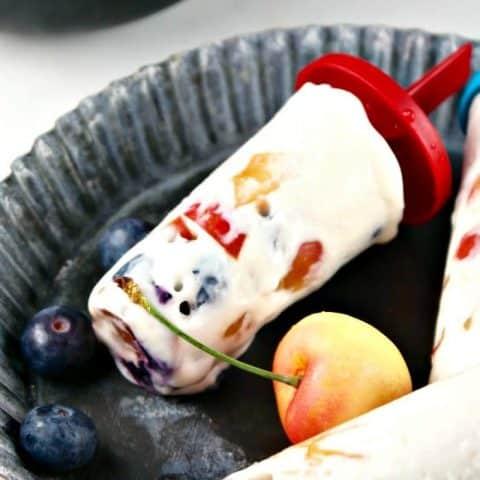 Protein Ice Cream recipe with fresh fruit on a tin tray