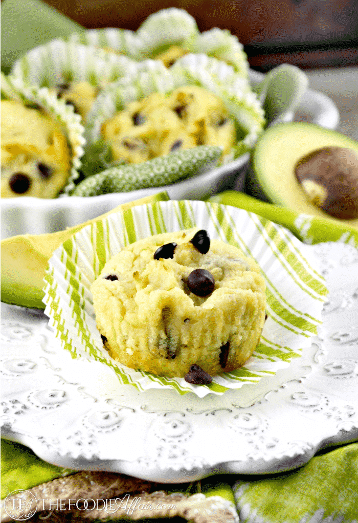Avocado muffins with chocolate chips on a white plate