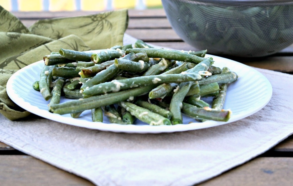roasted beans on a white plate are a delicious side or appetizer!