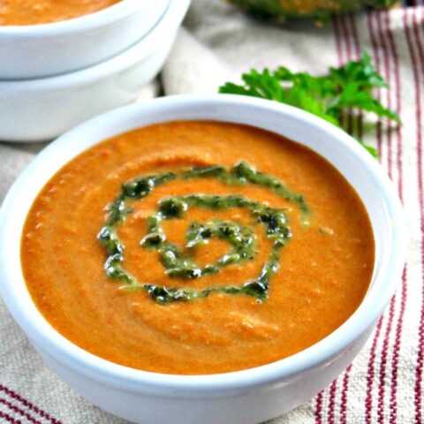 Carrot soup with curry in a white bowl