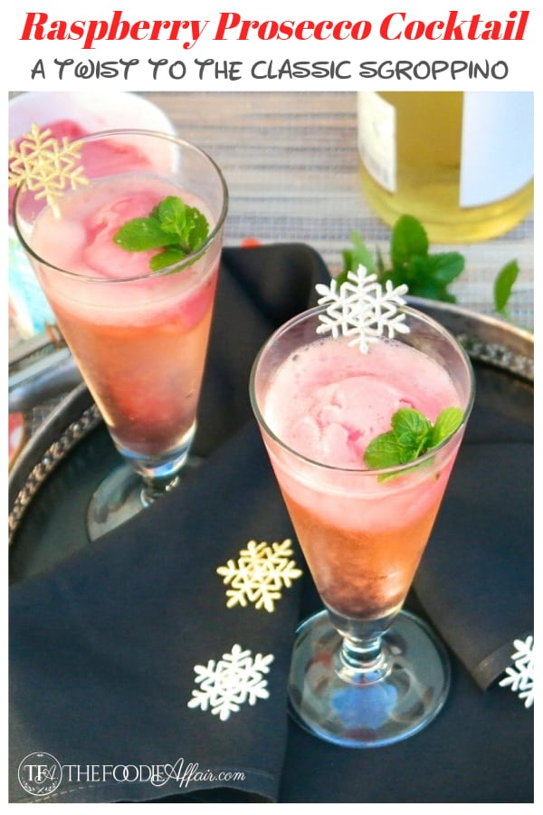 Italian raspberry prosecco cocktail is a twist to the classic Sgroppino! A combination of vodka, prosecco and raspberry sorbet instead of lemon! Add this festive drink to your next celebration #cocktail #prosecco #sgroppino #party #celebration #thefoodieaffair