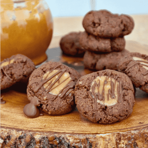 Low carb chocolate thumbprint cookies with a caramel center and sugar free chocolate drizzle #lowcarb #thumbprint #chocolate #cookies   www.thefoodieaffair.com