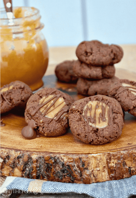 Low carb chocolate thumbprint cookies with a caramel center and sugar free chocolate drizzle #lowcarb #thumbprint #chocolate #cookies | www.thefoodieaffair.com