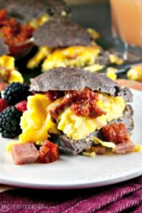 Low Carb Breakfast Sandwich filled with fluffy eggs folded with ham and melted cheese! Serve a crowd or wrap up for a grab and go meal! #breakfast #sandwich #lowcarb #keto | www.thefoodieaffair.com
