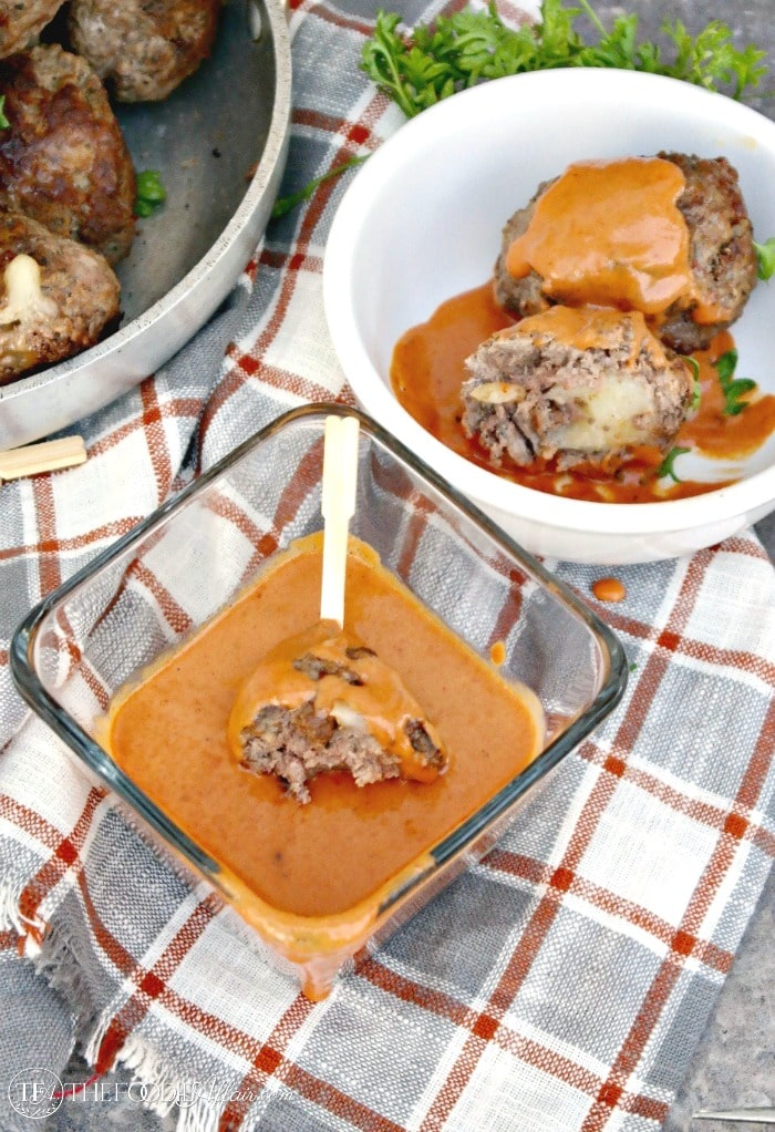 Cheese Stuffed Meatballs with a Creamy Tomato Sauce! Enjoy as an appetizer or serve with pasta #meatballs #cheese #Italian #LCHF   www.thefoodieaffair.com