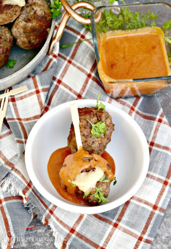 Cheese Stuffed Meatballs with a Creamy Tomato Sauce! Enjoy as an appetizer or serve with pasta #meatballs #cheese #Italian #LCHF | www.thefoodieaffair.com