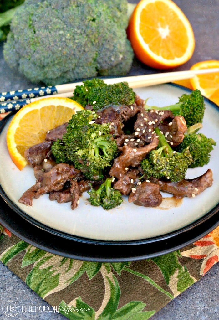 Beef and broccoli stir fry recipe on a cream plate with a black rim.