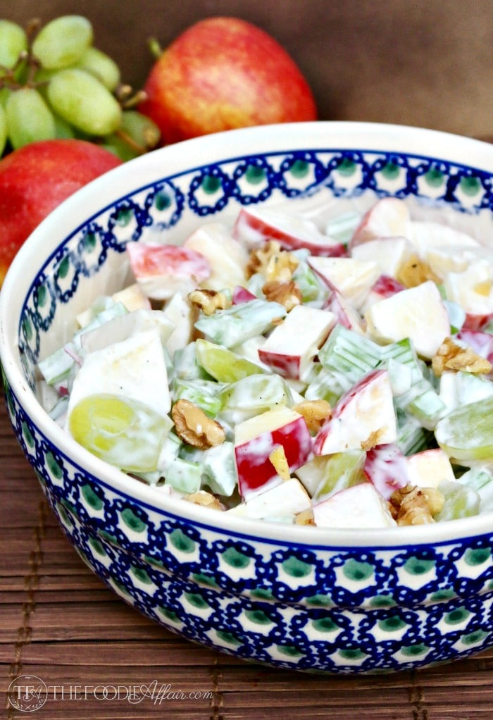 Classic Waldorf Salad with chunks of apple, sliced grapes folded in a creamy dressing #salad #waldorf #lunch   www.thefoodieaffair.com