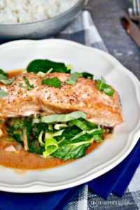 Salmon Coconut Red Curry Sauce over sautéed greens #keto #salmon #coconut | www.thefoodieaffair.com