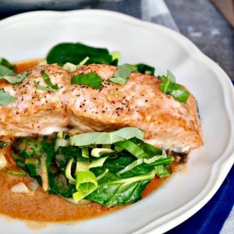 Salmon Coconut Red Curry Sauce over sautéed greens #keto #salmon #coconut | www.thefoodieaffair.com