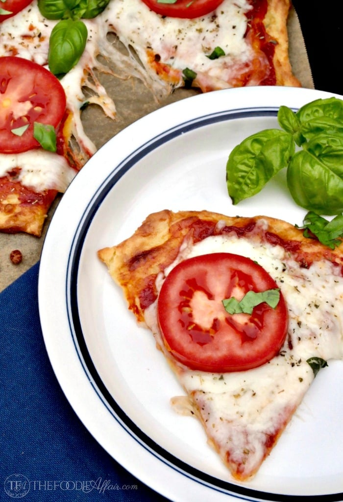 Low Carb Pizza Dough Recipe topped with fresh tomatoes and basil #low carb #recipe | www.thefoodieaffair.com