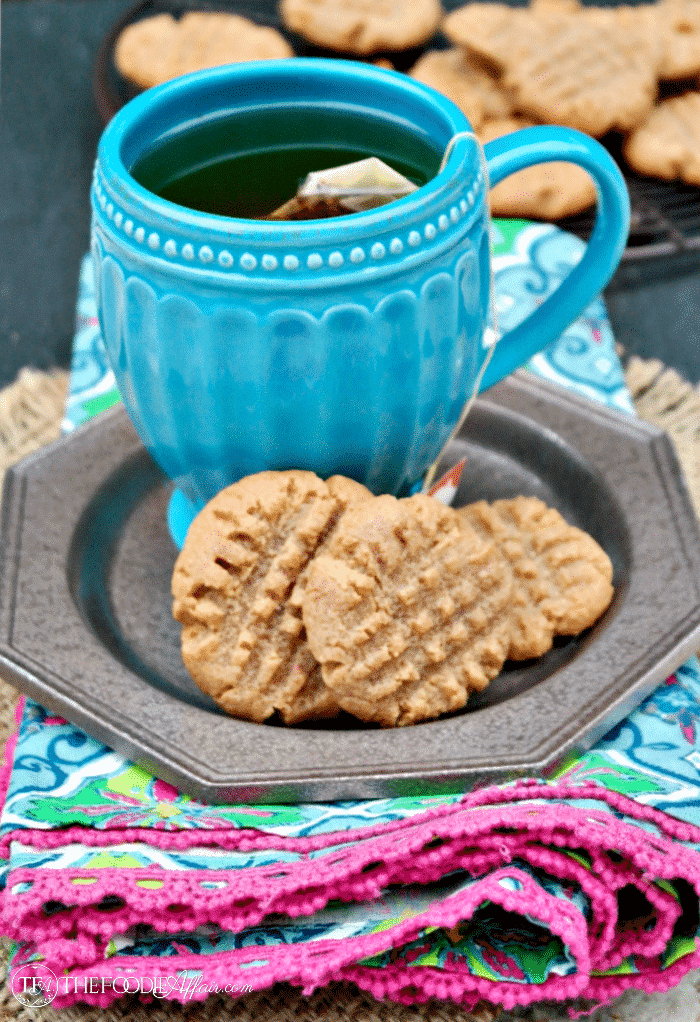 sugar free peanut butter cookies with tea in a teal cup