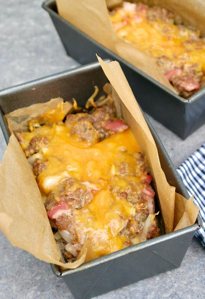 Low carb meatloaf in mini loaf pans cooked with melted cheese on top