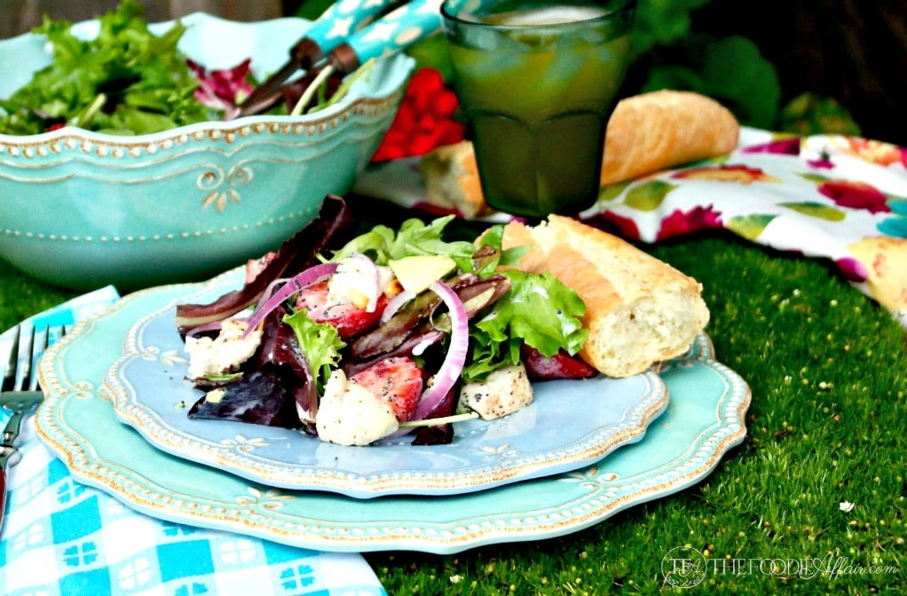 salad picnic idea: Strawberry Avocado Chicken Salad on a blue lightweight plate.