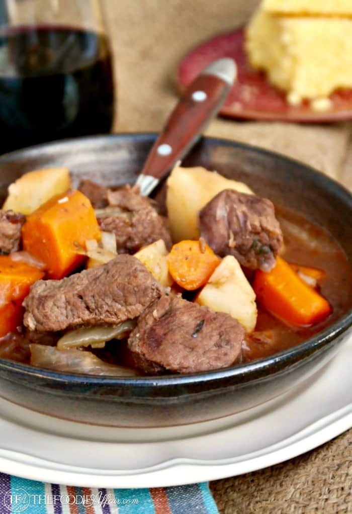 pressure cooker beef stew in a bowl with carrots