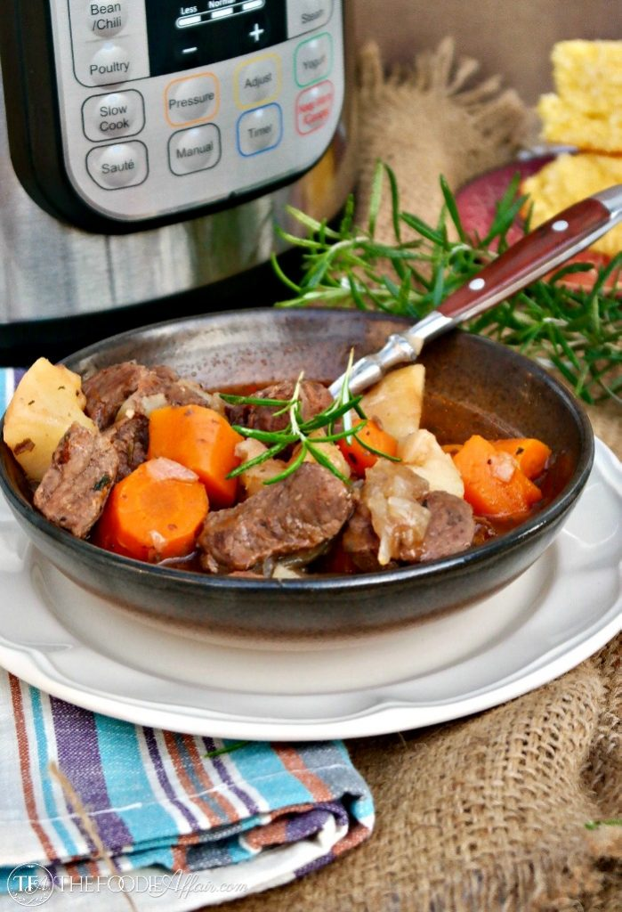 Hearty pressure cooker beef stew in a brown bowl