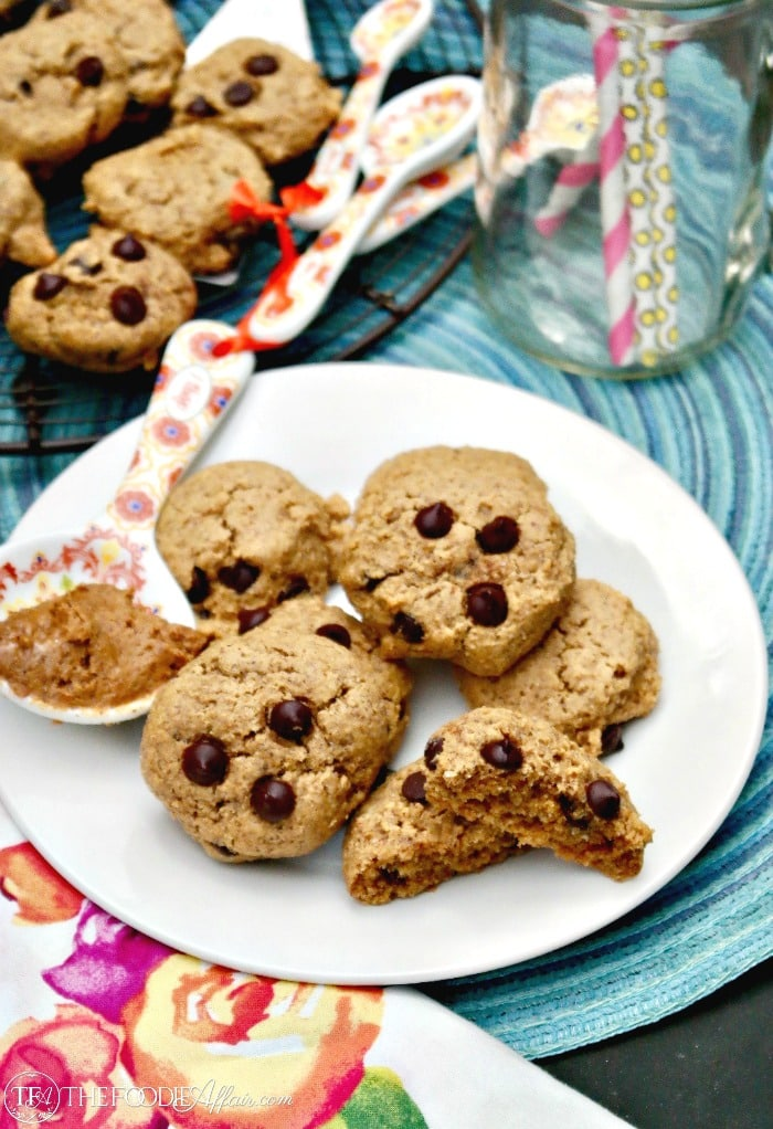 Soft almond flour cookies with sugar free chocolate chips on a white plate