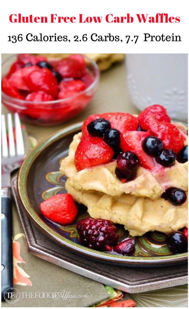Low Carb Waffles on a green plate topped with red strawberries and purple blueberries