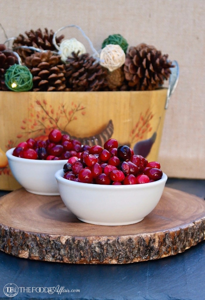 Fresh cranberries in white bowls to be cooked into a healthy cranberry sauce #CranberrySauce #Thanksgiving #SugarFree #LowCarb