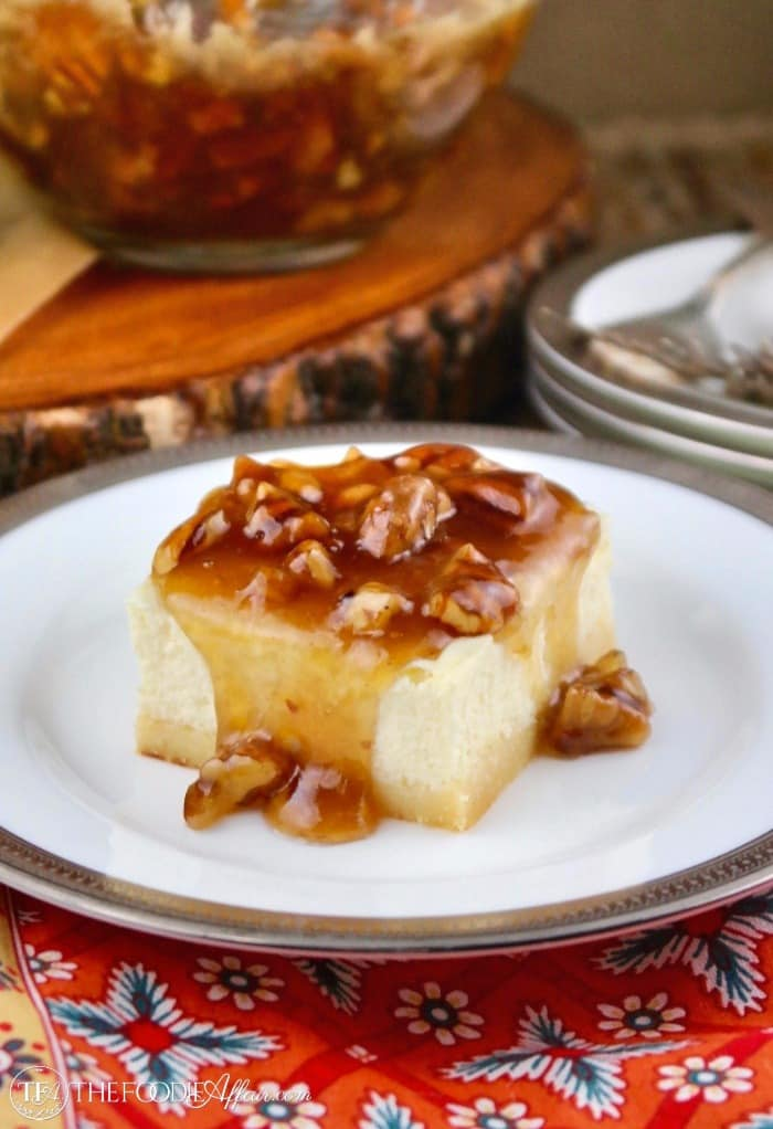 Creamy sugar free cheesecake bars with a maple pecan topping on a white plate with a silver rim #Cheesecake #SugarFree #LowCarb | www.thefoodieaffair.com