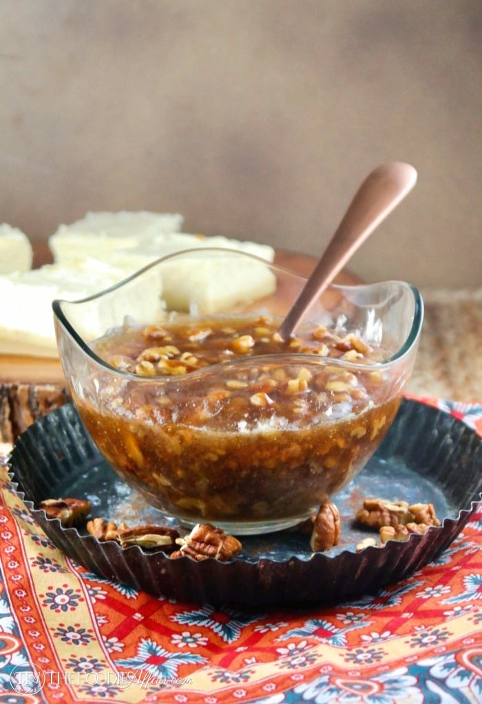 Maple pecan topping in a glass bowl for sugar free cheesecake bars #Pecan #Maple #Topping | www.thefoodieaffair.com