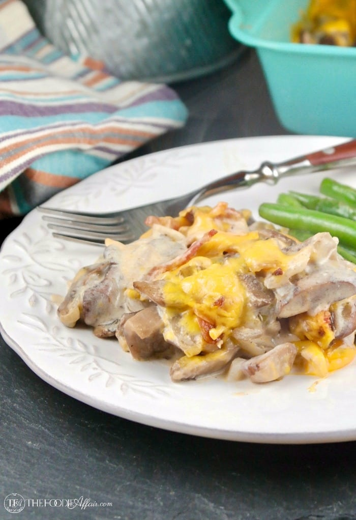 Cheesy mushroom casserole with bacon on a white plate with fresh green beans #casserole #Keto #mushroom #Bacon | www.thefoodieaffair.com