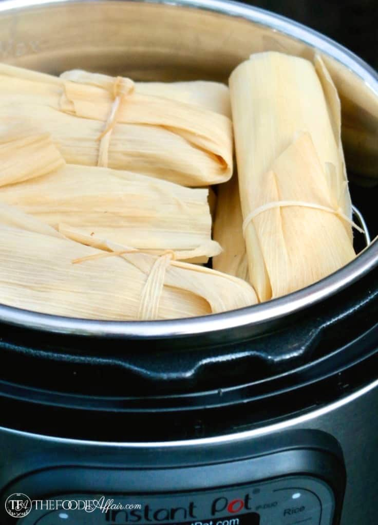 Prepared wrapped homemade tamales in a pressure cooker ready to be steamed #tamales #homemade #Mexican #Recipe | www.thefoodieaffair.com