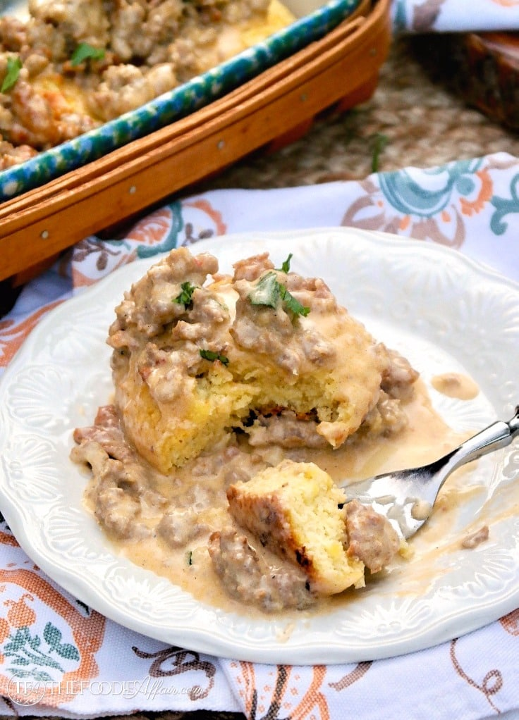 Homemade low carb biscuits and sausage gravy casserole plated on a white dish #sausage #gravy #lowcarb | www.thefoodieaffair.com
