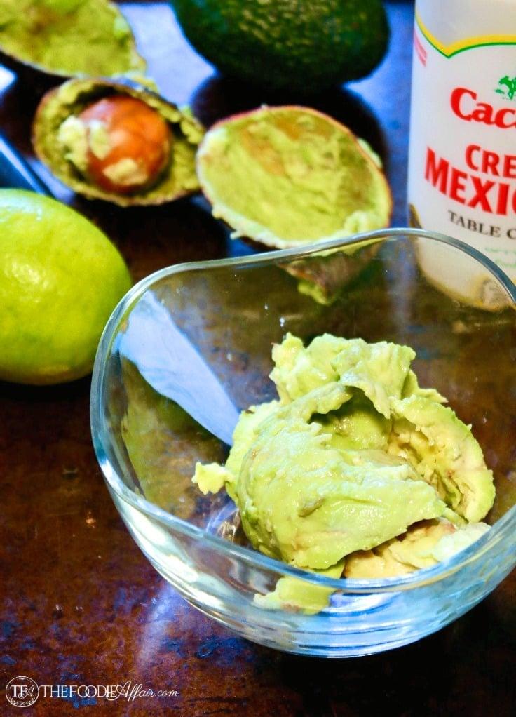 Fresh avocado flesh in a clear bowl to make avocado cream sauce #avocado #dip #recipe | www.thefoodieaffair.com