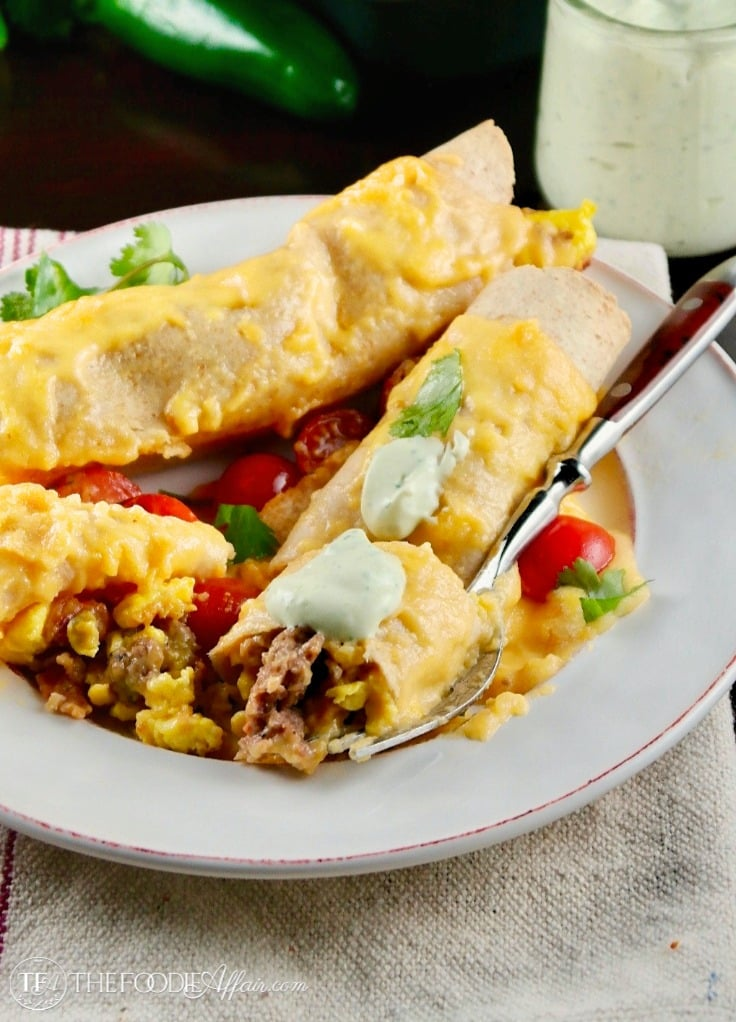 Two enchilada style wraps made into a healthy breakfast casserole on a white plate.