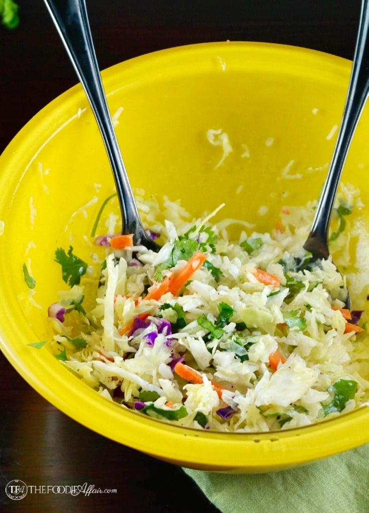 The cole slaw in a yellow bowl to add to healthy fish tacos #coleslaw #tacos #healthy | www.thefoodieaffair.com